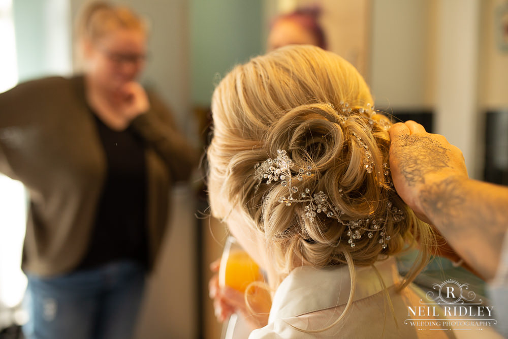 Manchester Wedding Photographer image of the bride to be hair style from the back.