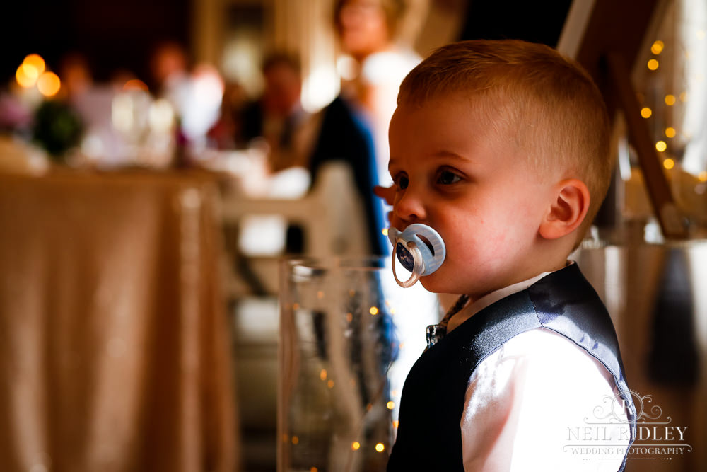 Bartle Hall Wedding Photographer Child with dummy