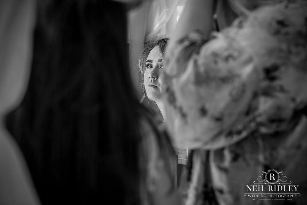 Manchester Wedding Photographer black and white image of bridesmaid during bridal prep