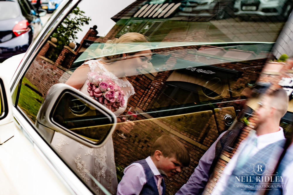 Manchester Wedding Photographer  reflection of bride in limo window