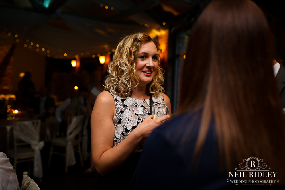 Bartle Hall Wedding Photographer blonde guest talking