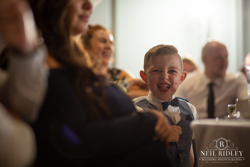 Manchester Wedding Photographer  Small boy pulling tongue out