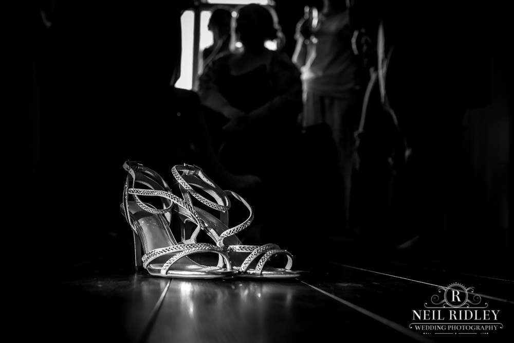 Manchester Wedding Photographer black and white image of bride's Kurt Geiger shoes on floor
