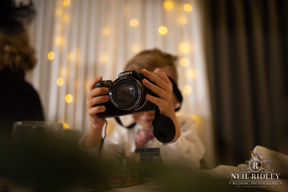 Manchester Wedding Photographer  top table child with camera