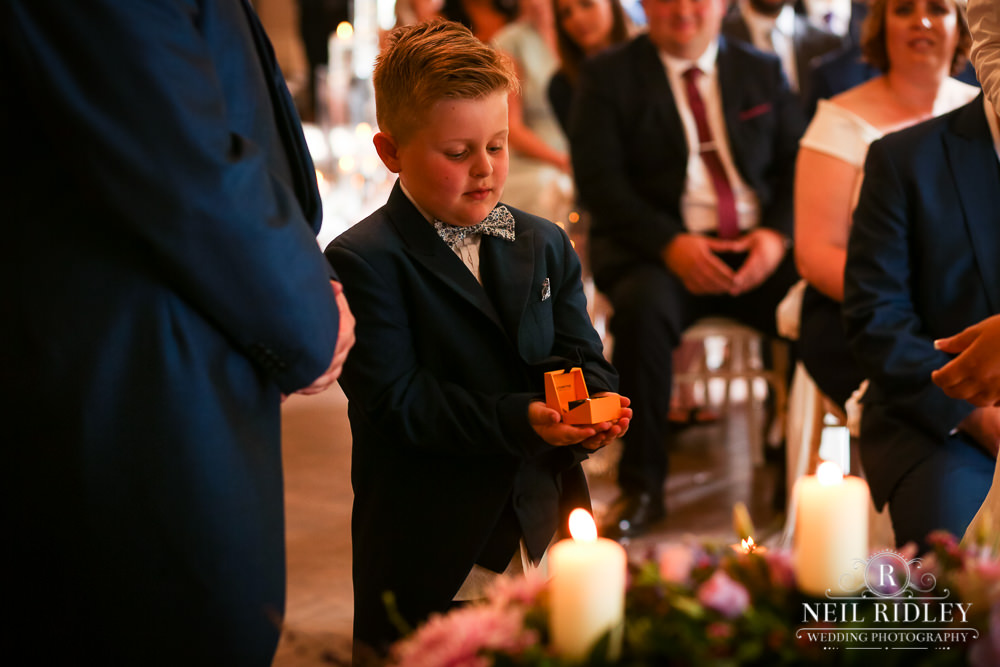 Bartle Hall Wedding Photographer Page boy holding rings