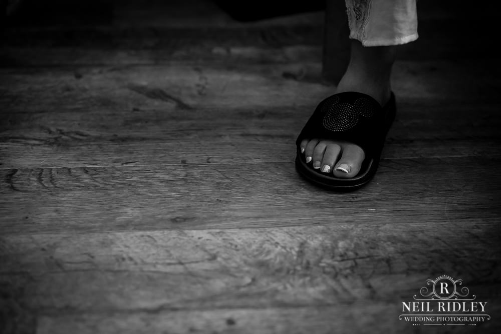 Manchester Wedding Photographer  black and white image of foot in a flip flop