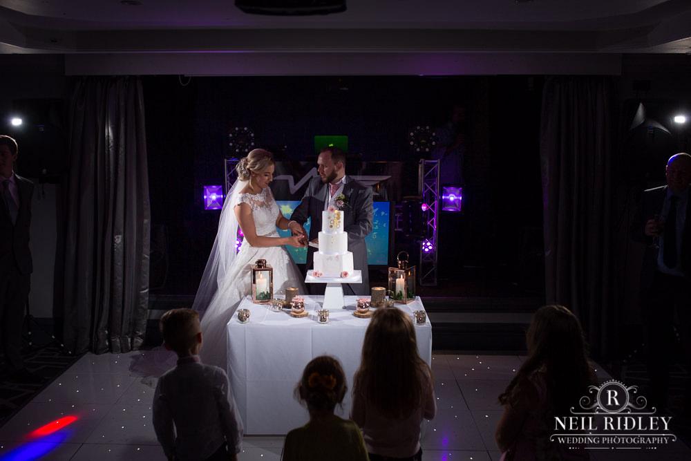The Villa Hotel Wedding Photographer Cake Cut
