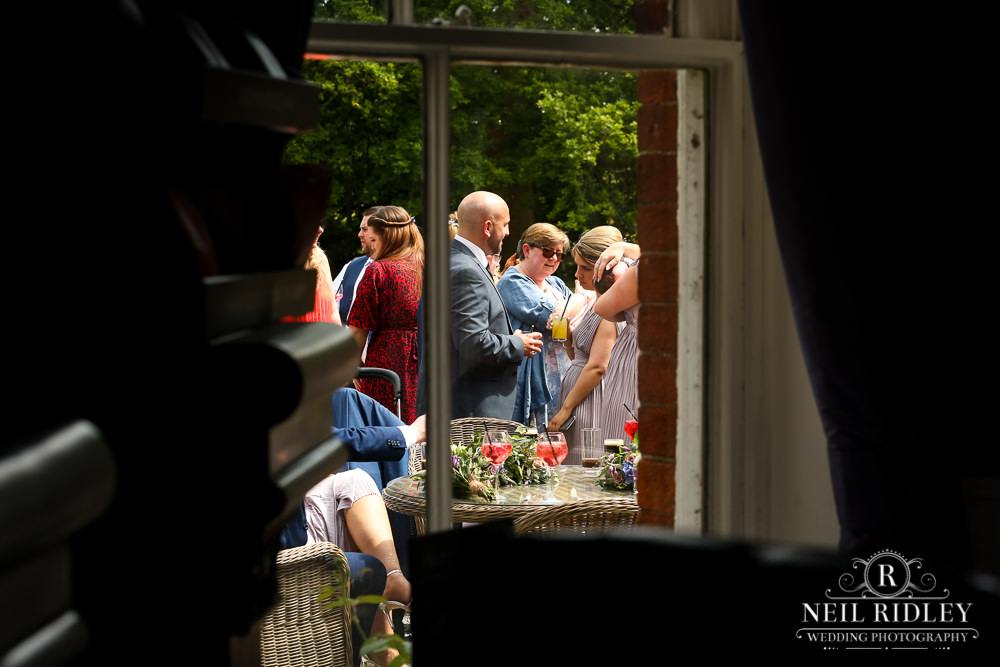 Bartle Hall Wedding Photographer view through a window