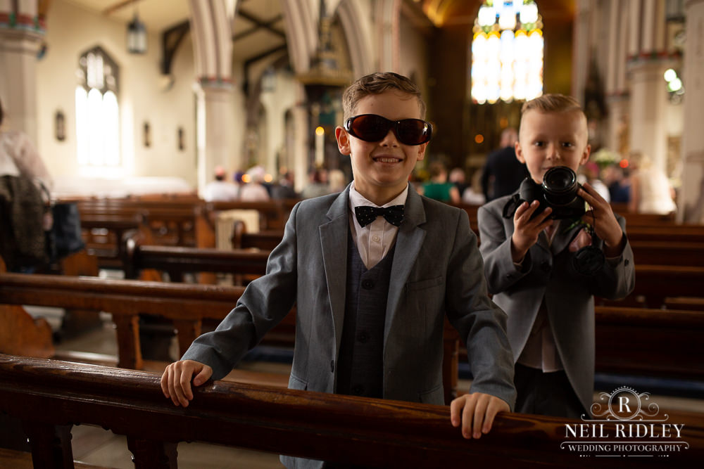 Manchester Wedding Photographer  pageboys in church