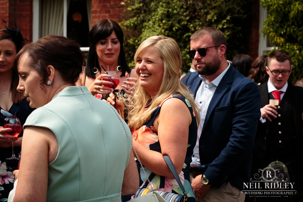 Bartle Hall Wedding Photographer Guests laughing