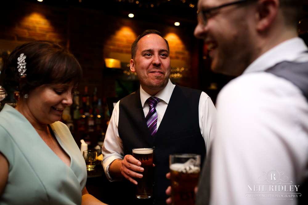 Bartle Hall Wedding Photographer Guests in the bar