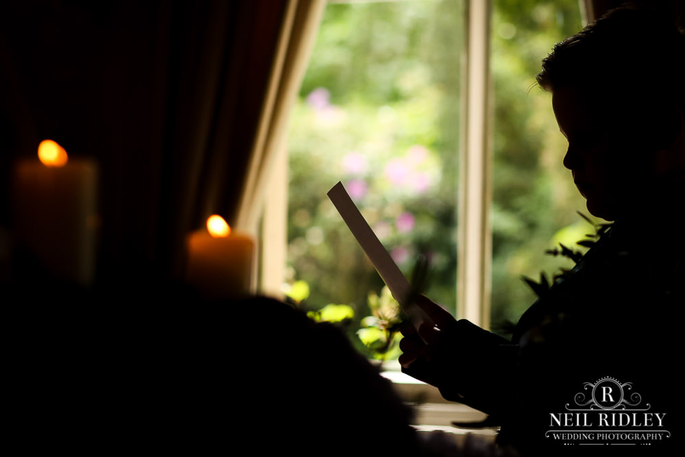 Bartle Hall Wedding Photographer silhouette of page boy reading