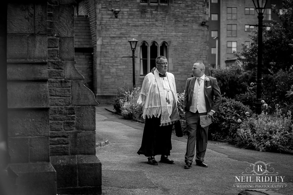 Manchester Wedding Photographer  Priest waiting for bride