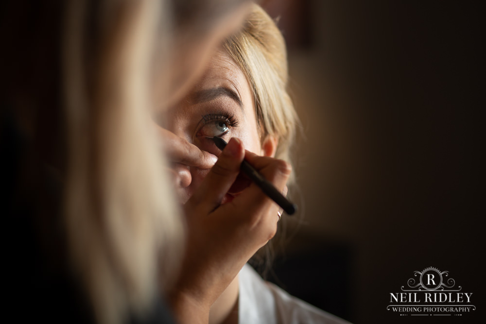 Manchester Wedding Photographer bride to be having eye make up applied by mua