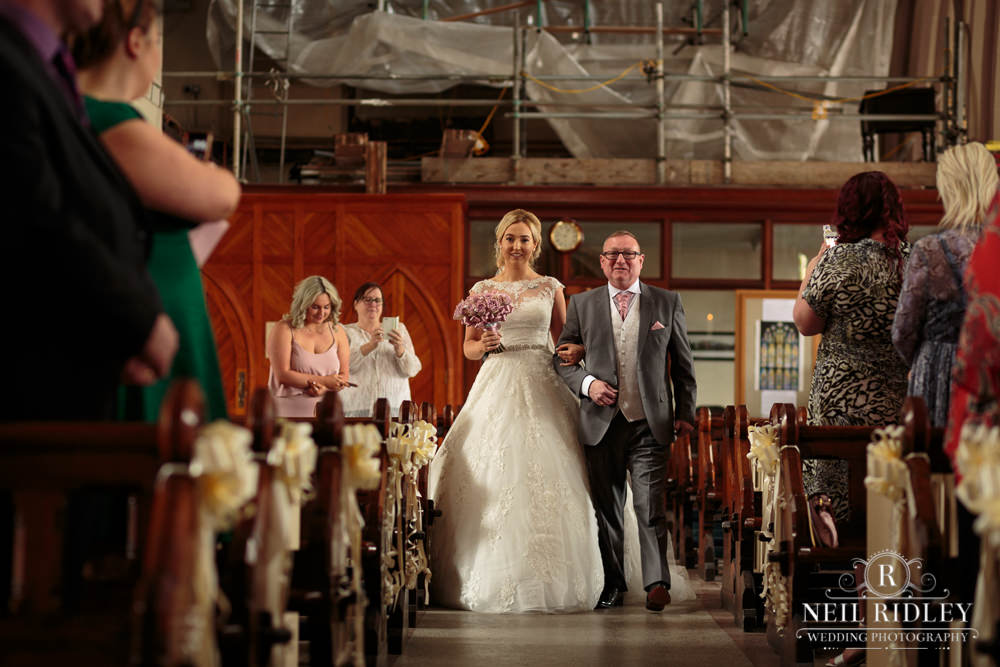 Manchester Wedding Photographer  Bride and Father walking down the aisle