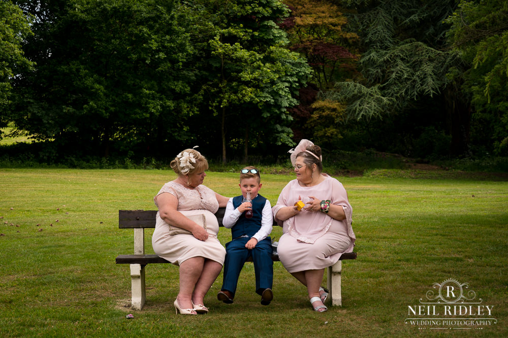 Bartle Hall Wedding Photographer Mothers on a bench with page boy