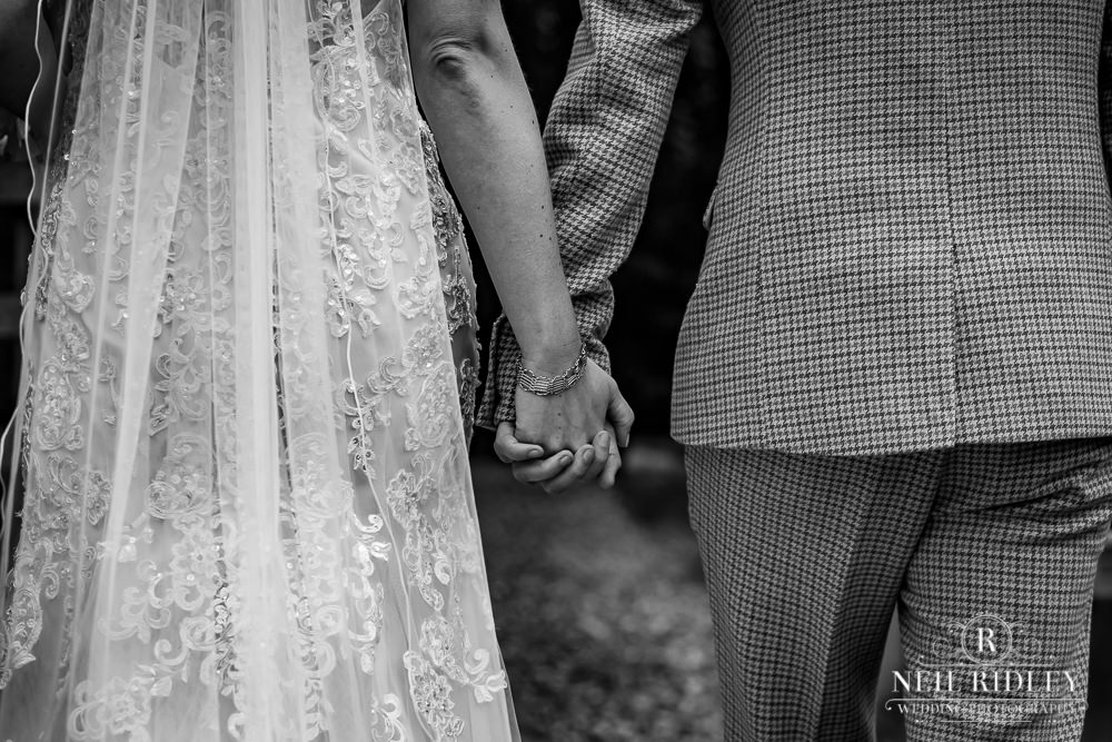Wyresdale Park Wedding - Bride and Groom holding hands