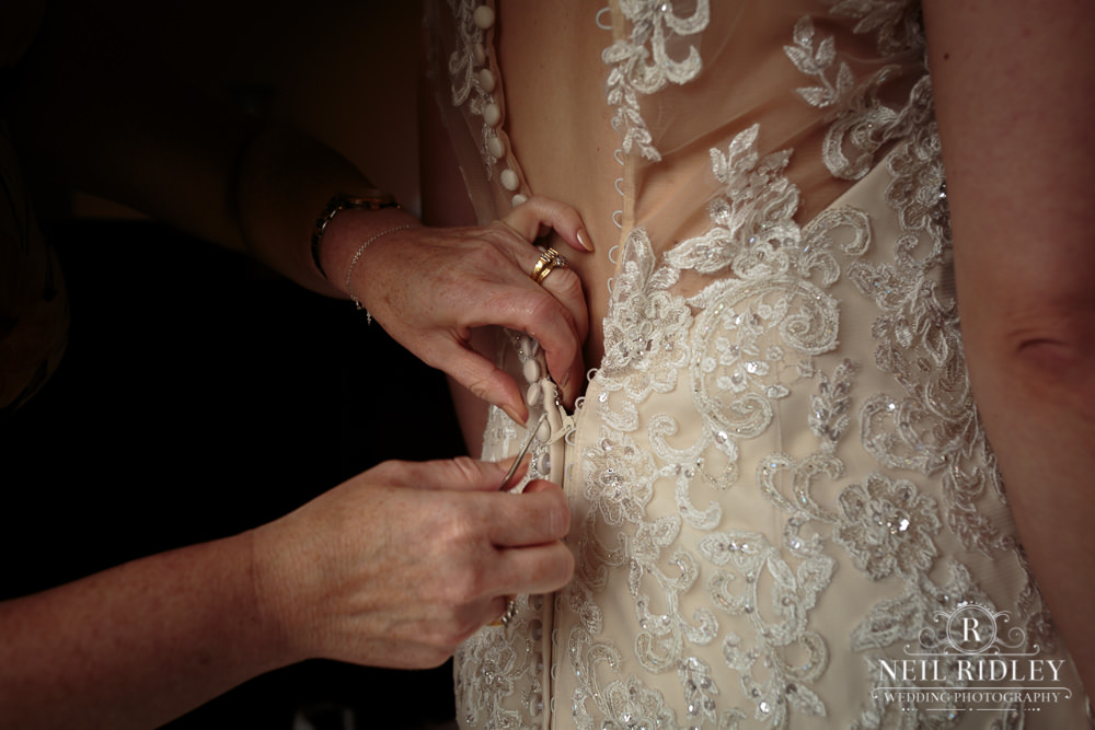 Wyresdale Park Wedding - Fastening the dress