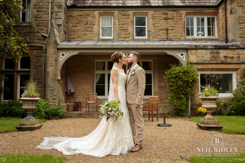 Wyresdale Park Wedding - Bride and Groom outside the house