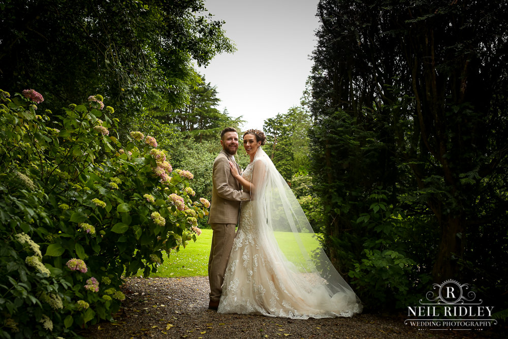 Wyresdale Park Wedding - Bride and Groom pose in the garden