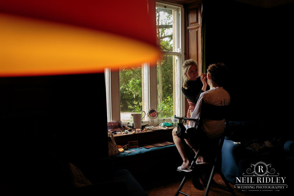 Wyresdale Park Wedding - Bride getting ready in the window