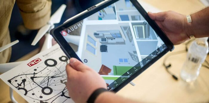 Virtual birds eye view of a floor plan displayed on a tablet.