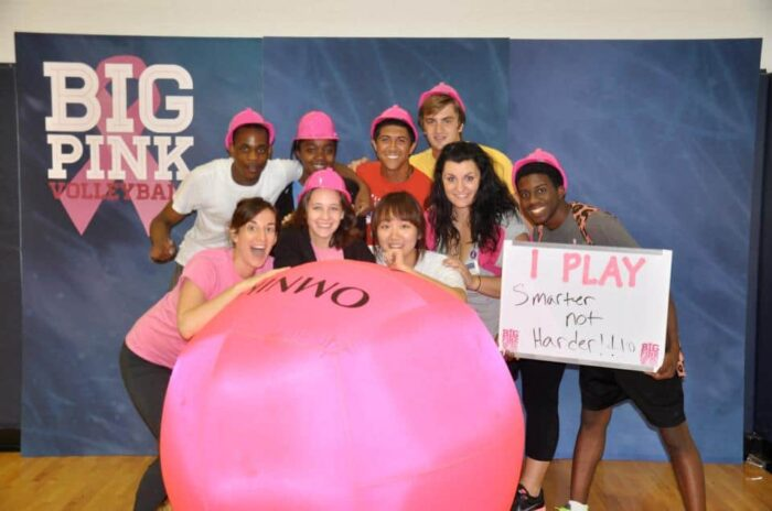 students with big pink ball and one student holding board 'I play smarter not harder!!'