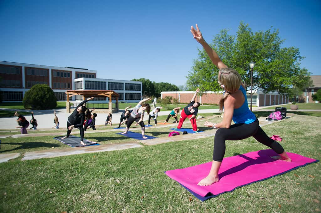 A group of students during a yoga session taught by another student.