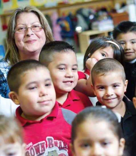 Maria Ruelas at LP Waters Early Childhood Center with kids