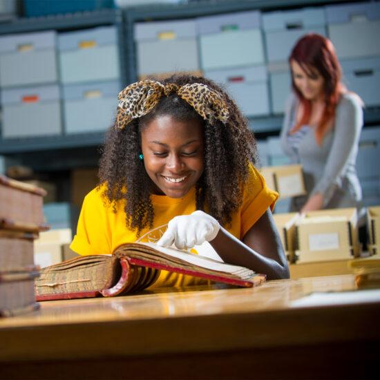 History student examine historical book.