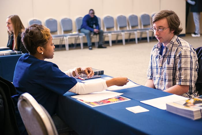 A student talking to a health professional.