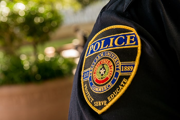 Close up of a police badge on uniform.