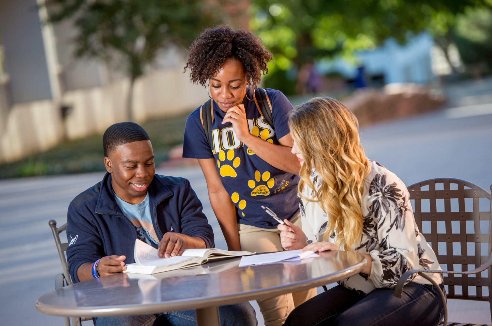 Group of students studying at a table.