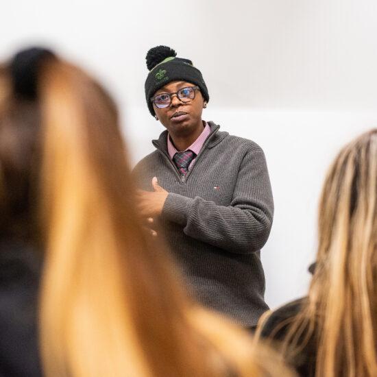 Student speaking in front of peers.