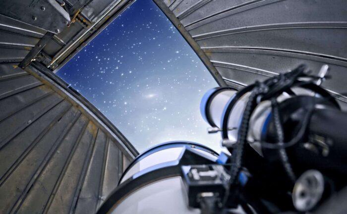 Image of telescope and stars.