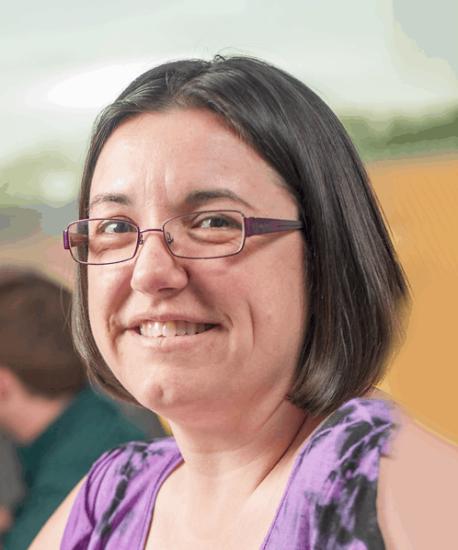 Photo of female wearing glasses.