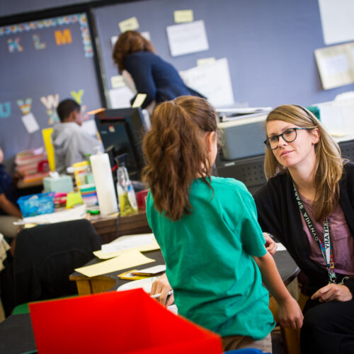 A teacher is listening to her student.