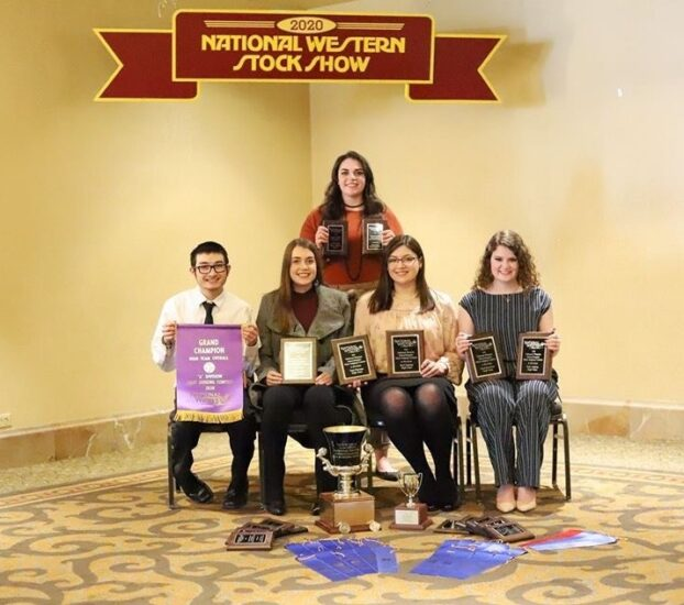 The Meat Judging team in a room with their awards.