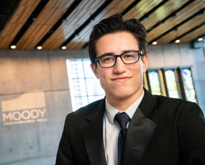 Young male musician wearing formal attire