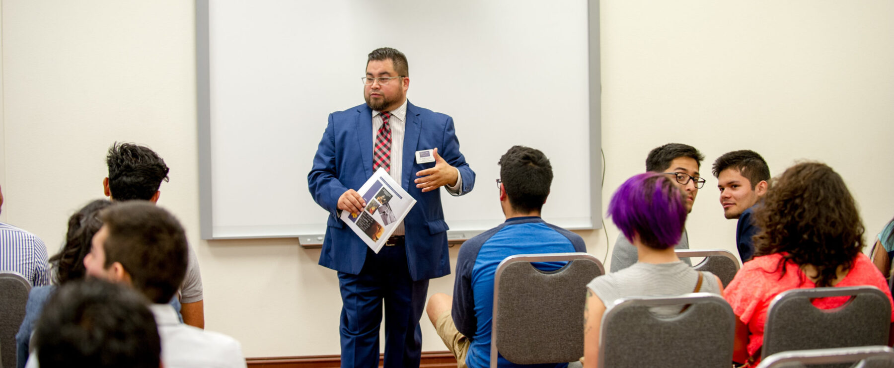 Dr. Fred Fuentes giving a presentation.