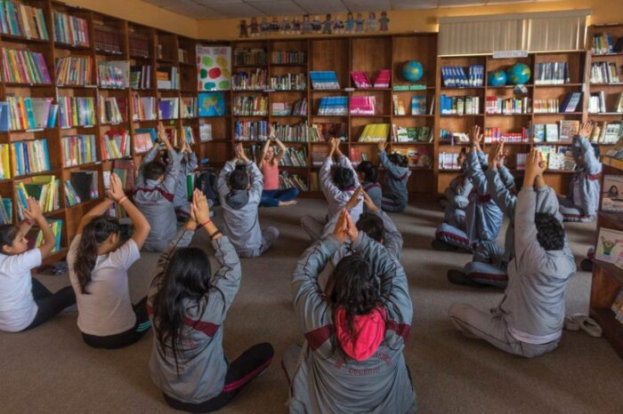 Students having a meditation session.