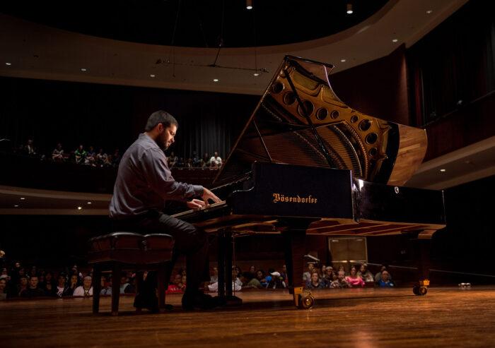 Lucas Arcizo playing piano.