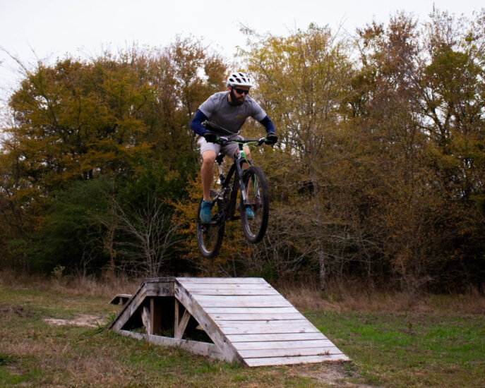 Biker riding on the biking trail at the Outdoor Adventure.