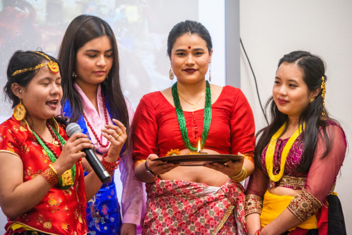 A group of student wearing traditional dresses during the diversity dinner event.