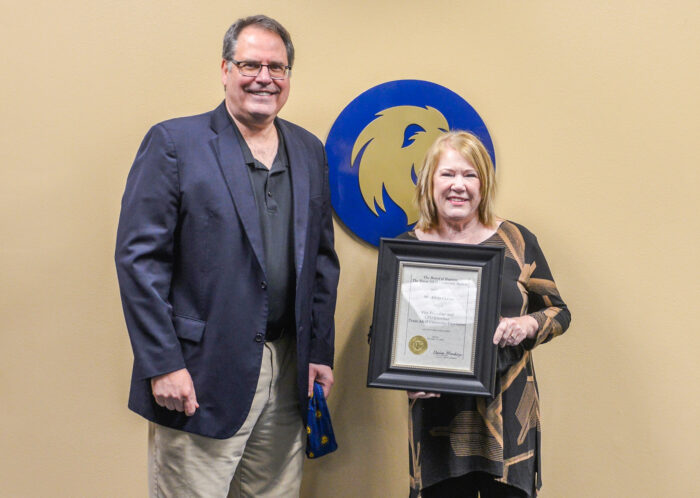 Alicia Currin receives am Emeritus honor from the A&M System, presented by Dr. Mark Rudin