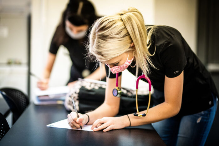 veterinarian technology student writing.