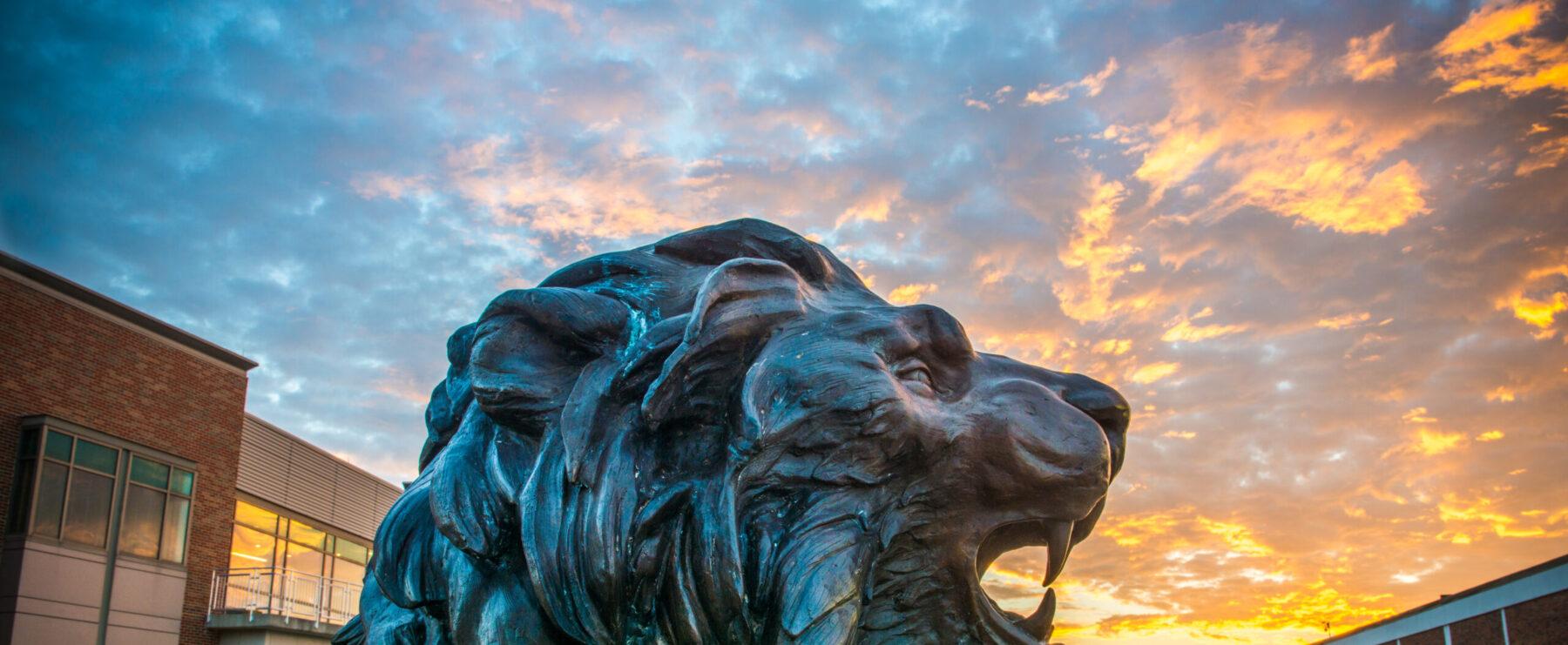 TAMUC lion statue at dusk