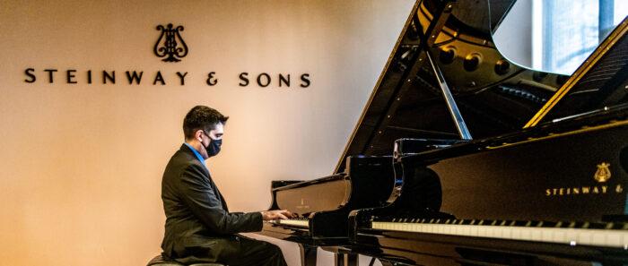 Luis Sanchez playing piano