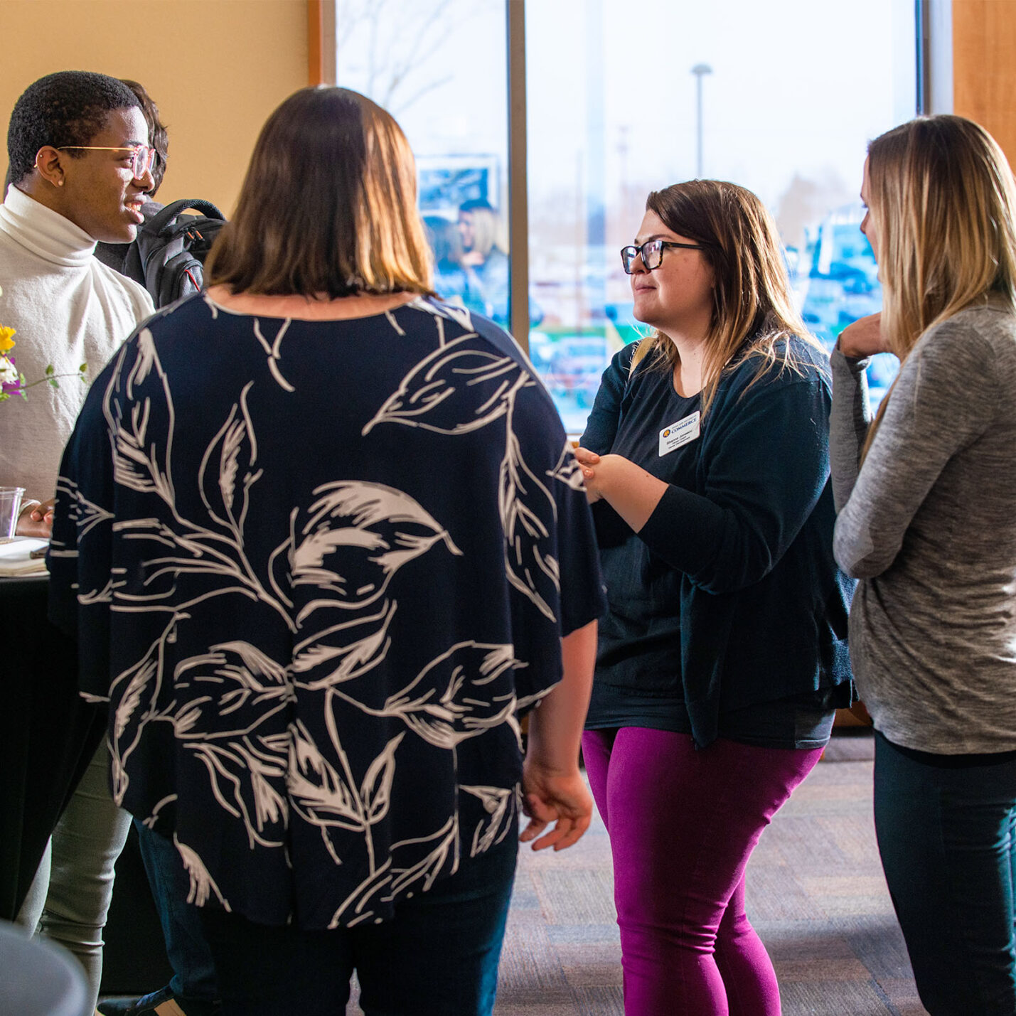 Students and Staff having a conversation during a student organization event.