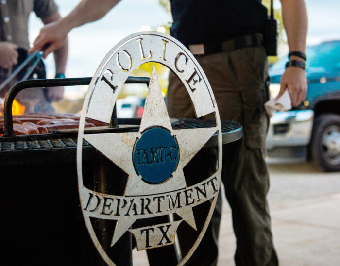 Grill with the University Police Department emblem on the side.